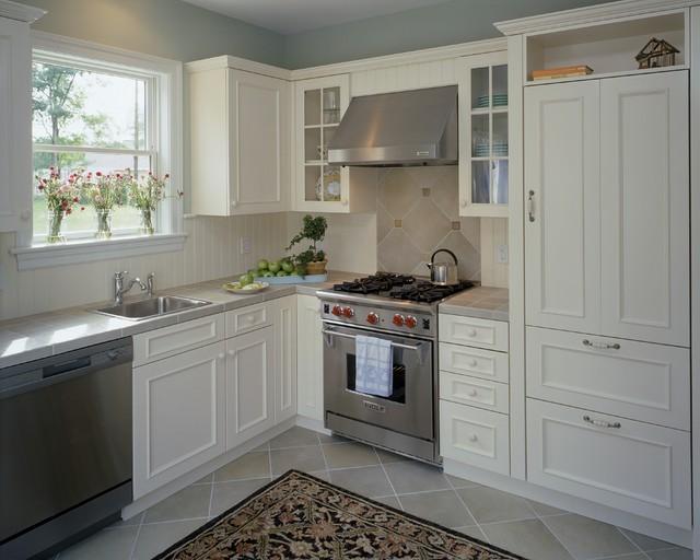 Elegant kitchen photo in Boston with tile countertops