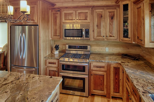 Broken bow ok rustic kitchen dallas by for Log cabin kitchen backsplash ideas