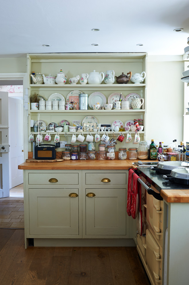 Eat-in kitchen - small victorian l-shaped medium tone wood floor eat-in kitchen idea with shaker cabinets, green cabinets and wood countertops
