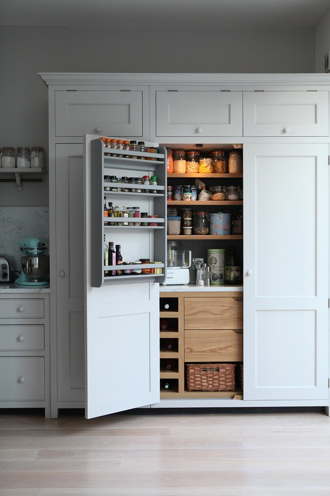 Mid-sized elegant single-wall light wood floor kitchen pantry photo in London with shaker cabinets, gray cabinets, marble countertops, gray backsplash, stone slab backsplash and an island
