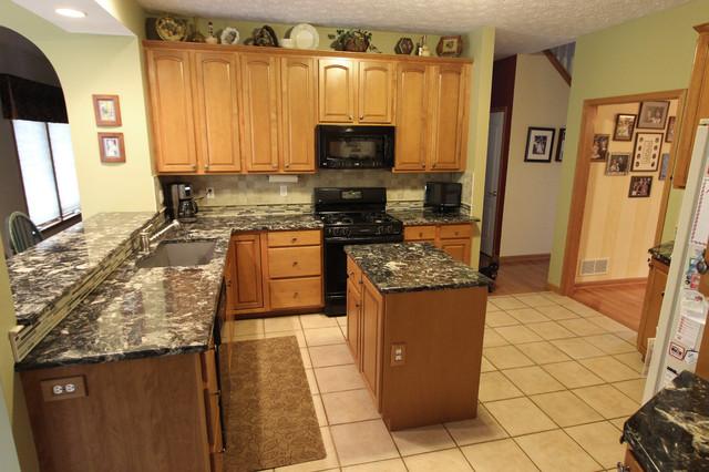 Brown Quartz Countertop With Beige Tile Backsplash