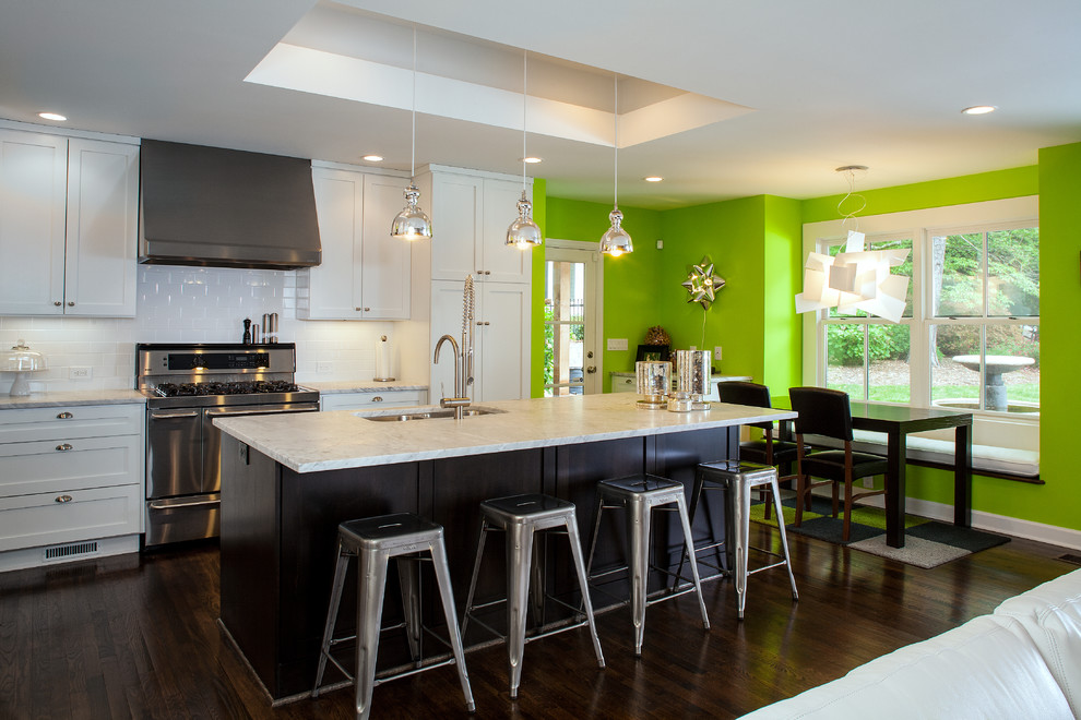 Inspiration for a contemporary eat-in kitchen remodel in Atlanta with an undermount sink, shaker cabinets, white cabinets, white backsplash and subway tile backsplash
