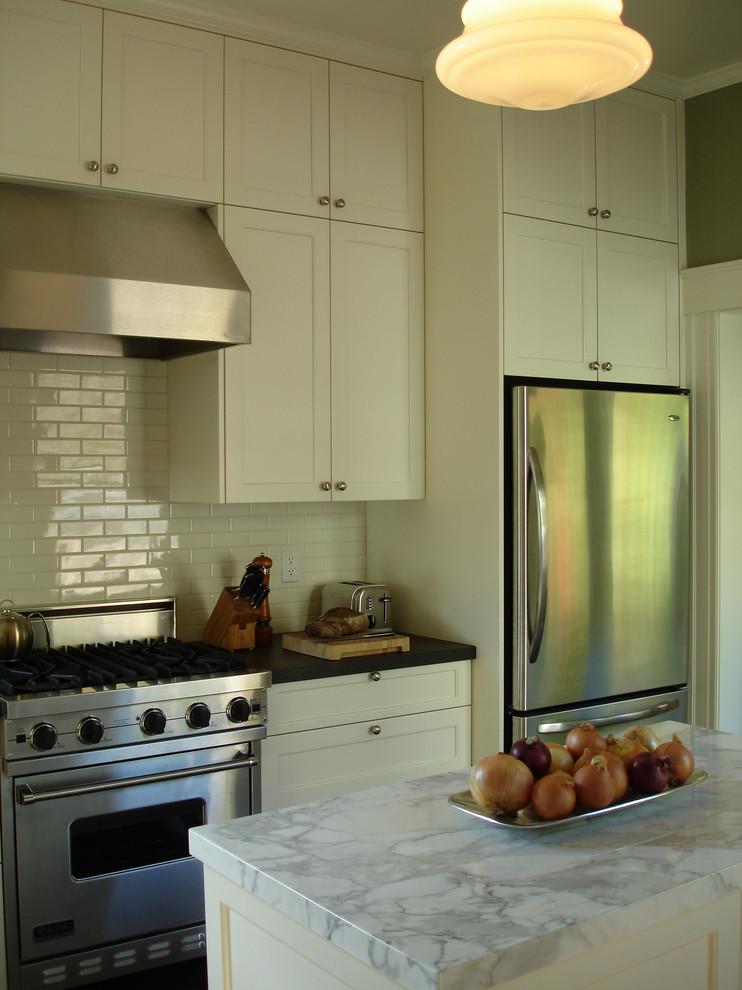 Elegant kitchen photo in San Francisco with subway tile backsplash and marble countertops