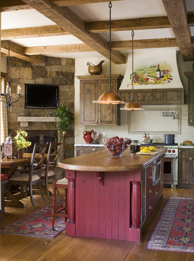 Inspiration for a rustic kitchen remodel in Denver with stainless steel appliances and wood countertops