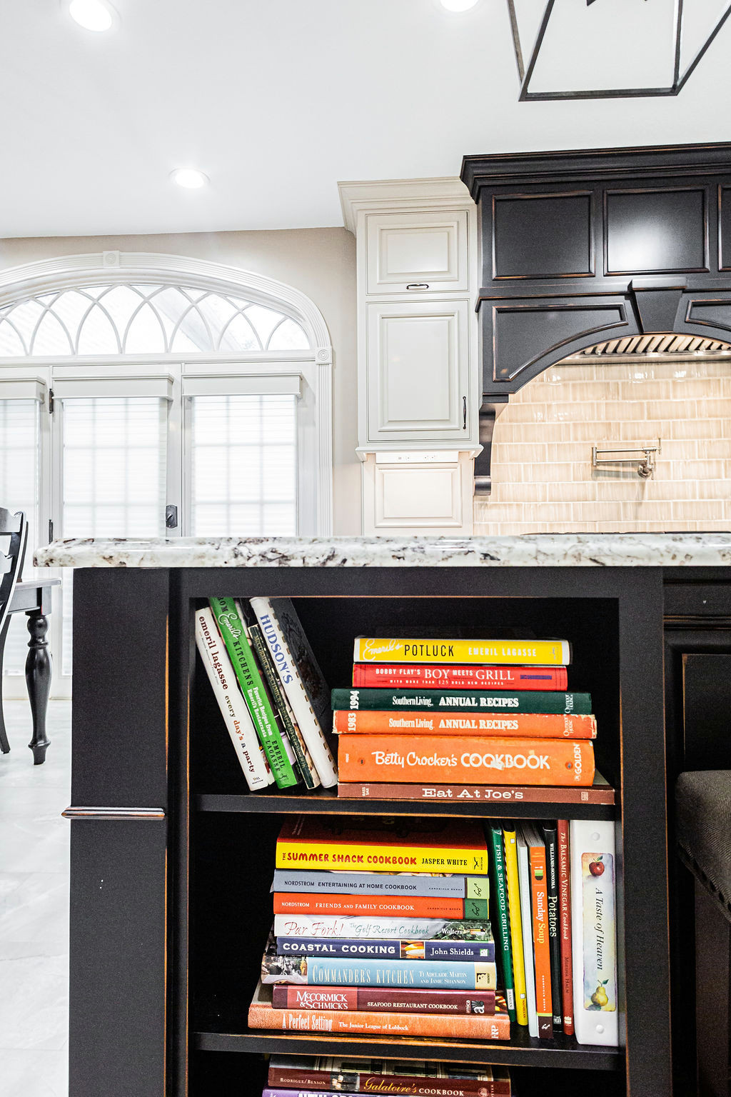 Built-in kitchen island book storage