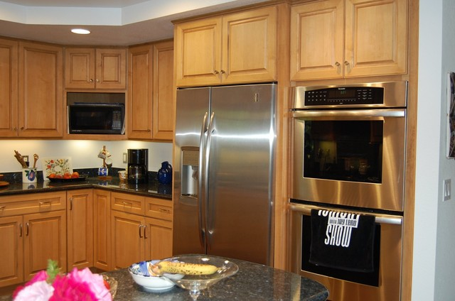 Built in look for a freestanding refrigerator traditional kitchen