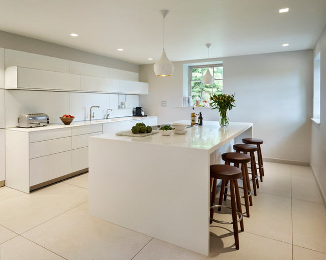 minimalist porcelain floor eatin kitchen photo in wiltshire with an integrated sink flat
