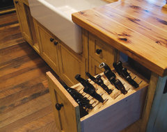 Rustic kitchen island with knife storage rustic-kitchen