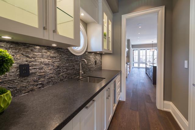 Large transitional single-wall medium tone wood floor kitchen pantry photo in Toronto with a single-bowl sink, shaker cabinets, white cabinets, granite countertops, black backsplash, mosaic tile backsplash, white appliances and no island