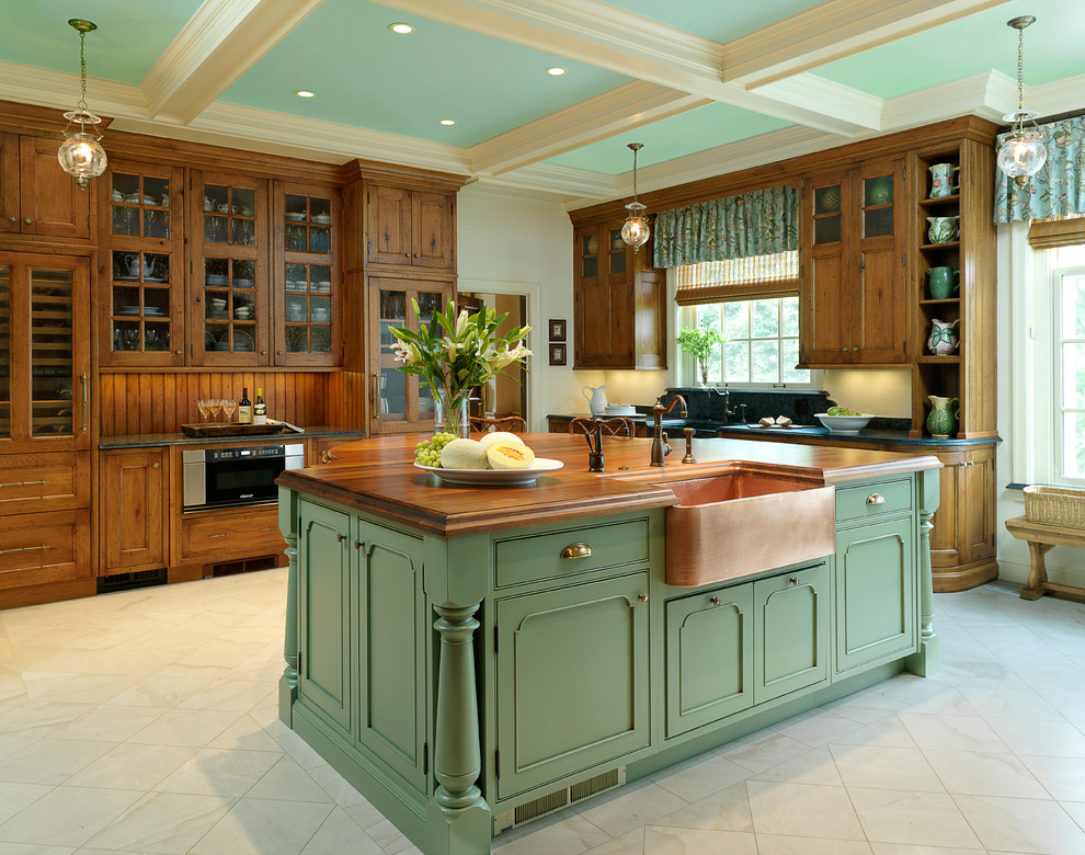 Example of a classic kitchen design in St Louis with beaded inset cabinets, a farmhouse sink, wood countertops and green cabinets
