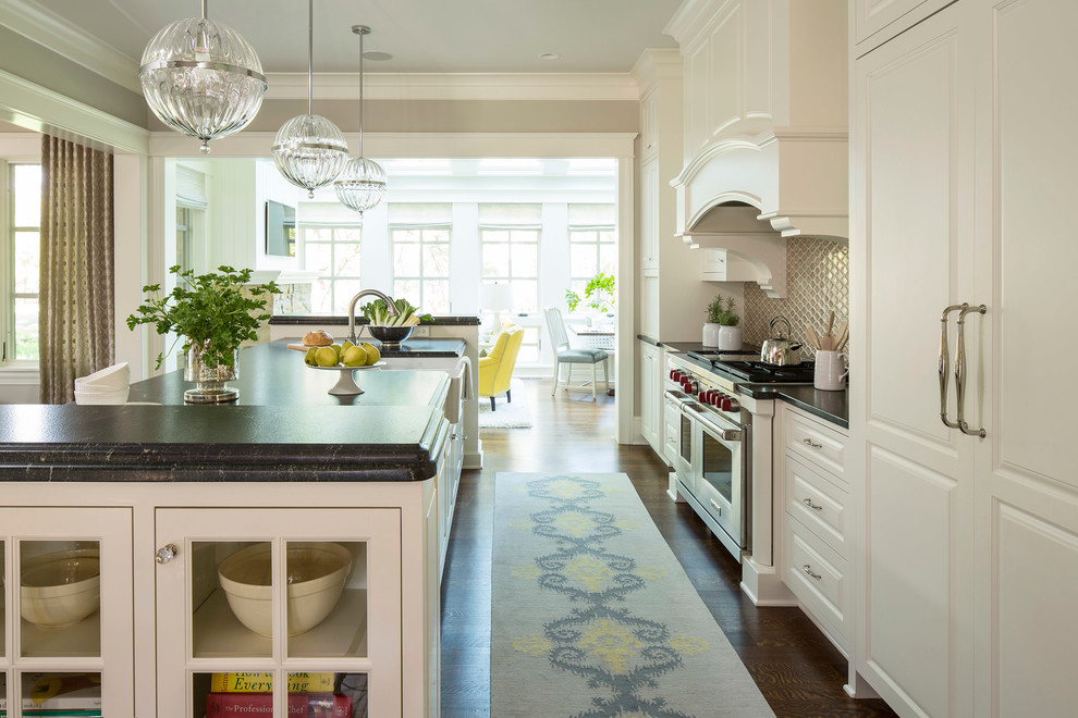 Kitchen - transitional kitchen idea in Minneapolis with paneled appliances