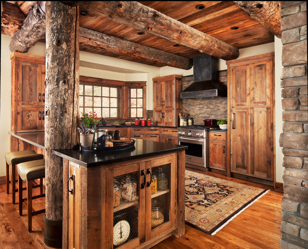 Inspiration for a mid-sized rustic u-shaped medium tone wood floor kitchen remodel in Detroit with shaker cabinets, medium tone wood cabinets, multicolored backsplash, matchstick tile backsplash, stainless steel appliances, a peninsula and solid surface countertops
