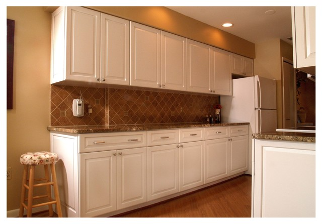 Cabinet renewal meets galley style white transitional for Renew it kitchen cabinets
