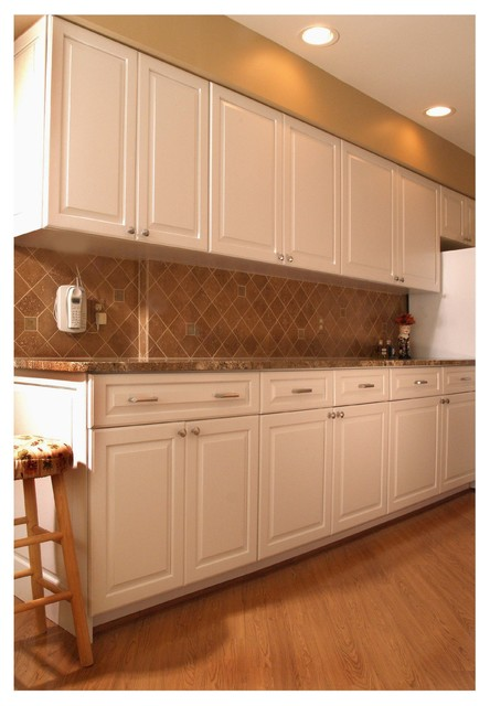 cabinet renewal meets galley style white transitional