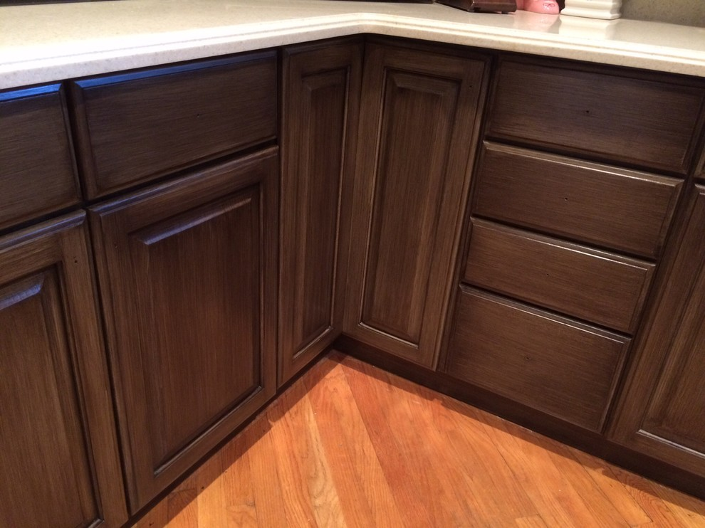 Inspiration for a craftsman kitchen remodel in Cincinnati with raised-panel cabinets and dark wood cabinets