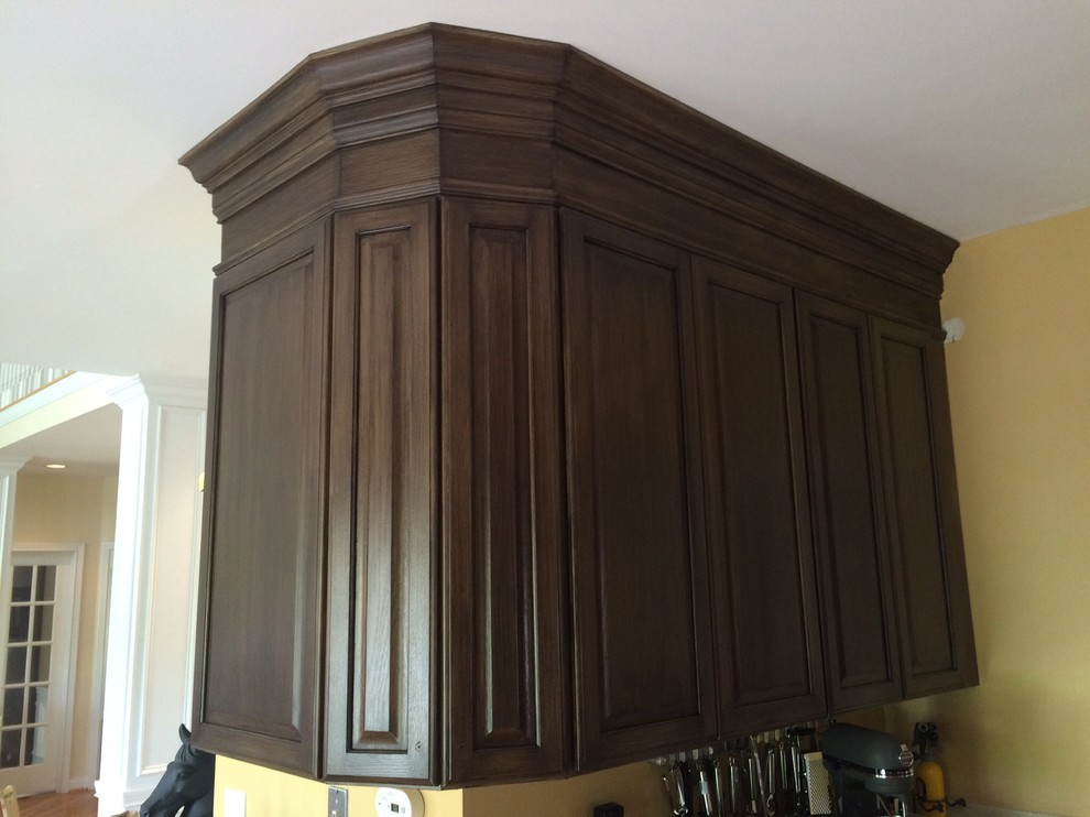 Arts and crafts kitchen photo in Cincinnati with raised-panel cabinets and dark wood cabinets