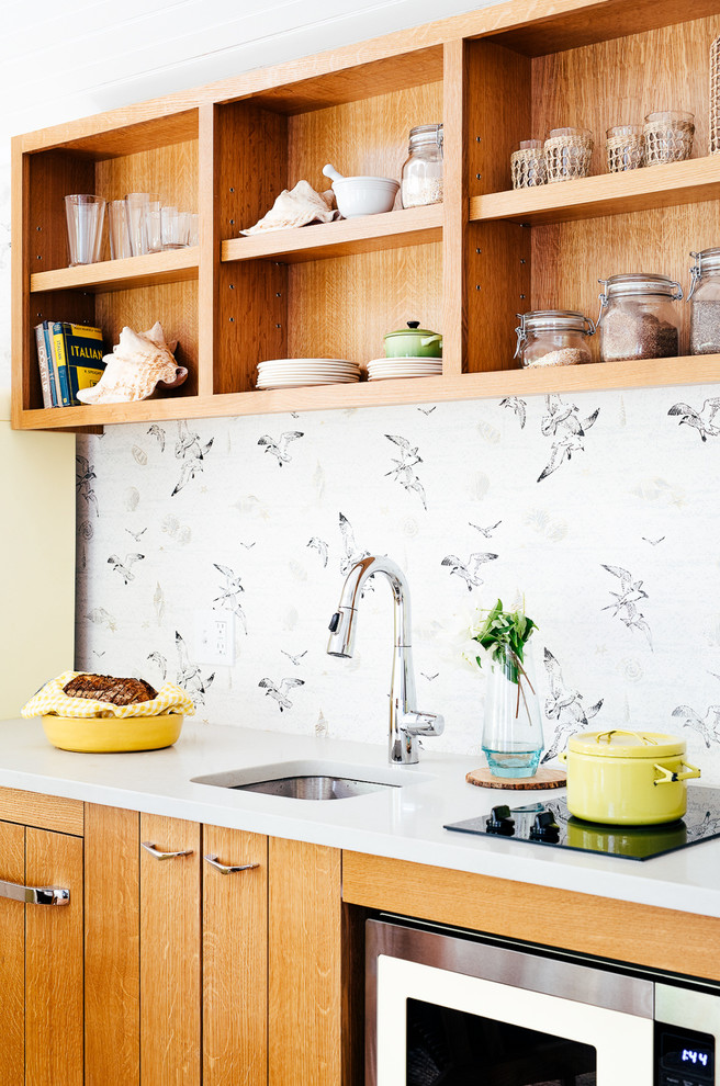 Inspiration for a small coastal single-wall medium tone wood floor kitchen remodel in Portland Maine with an undermount sink, flat-panel cabinets, medium tone wood cabinets, colored appliances and white countertops