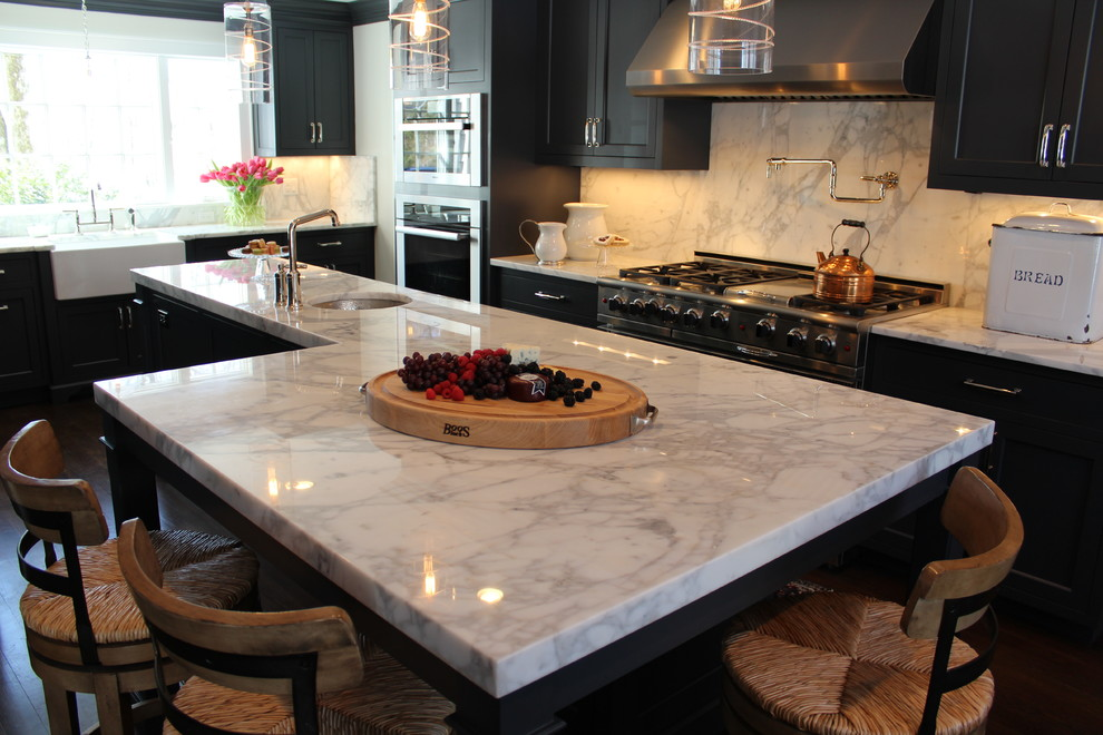 Transitional kitchen photo in New York with marble countertops