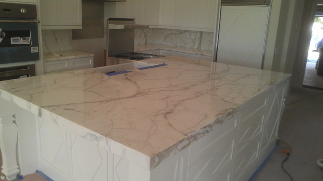 Calcatta Gold Marble Island  Traditional  Kitchen  tampa  by