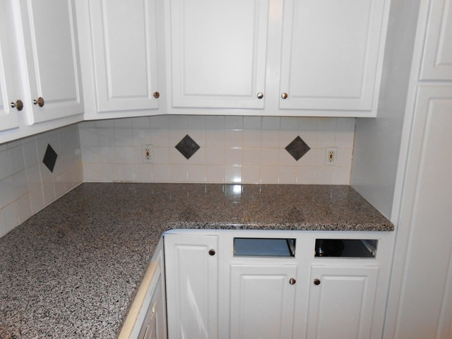 caledonia granite countertop pictures new with dark cabinets white traditional kitchen photos of countertops