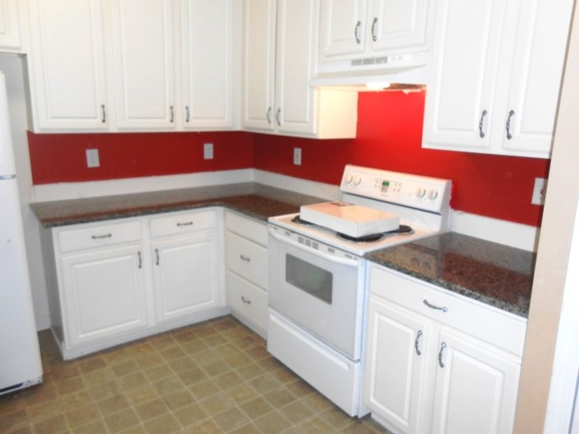 kitchen with white cabinets and red walls | roselawnlutheran