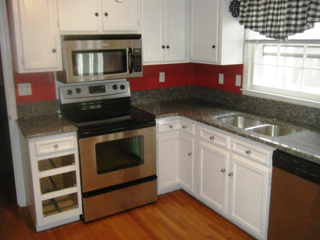 Caledonia granite for white cabinets traditional for Charlotte kitchen cabinets