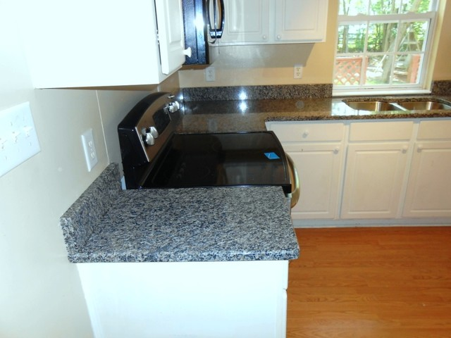 Caledonia Granite for White Cabinets traditional-kitchen