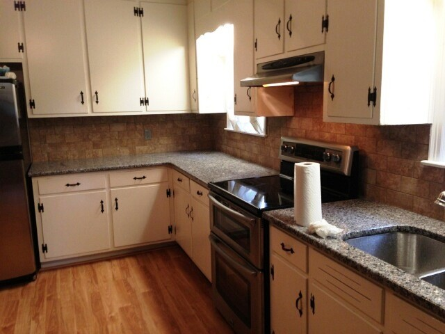 white kitchen cabinets with new caledonia granite caledonia granite for white cabinets traditional 29035