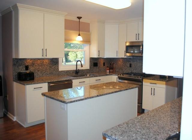 Caledonia Granite Tops and Backsplash, White  Rohe  Cabinets  Kitc