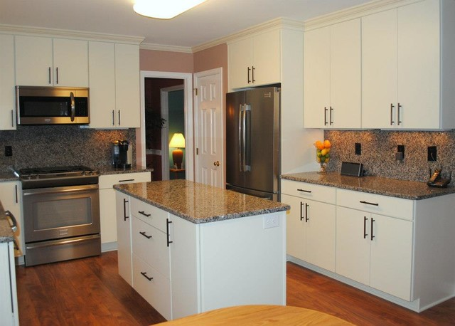 "White Kitchen Laminate Flooring caledonia granite tops and backsplash, white ""rohe"" cabinets"