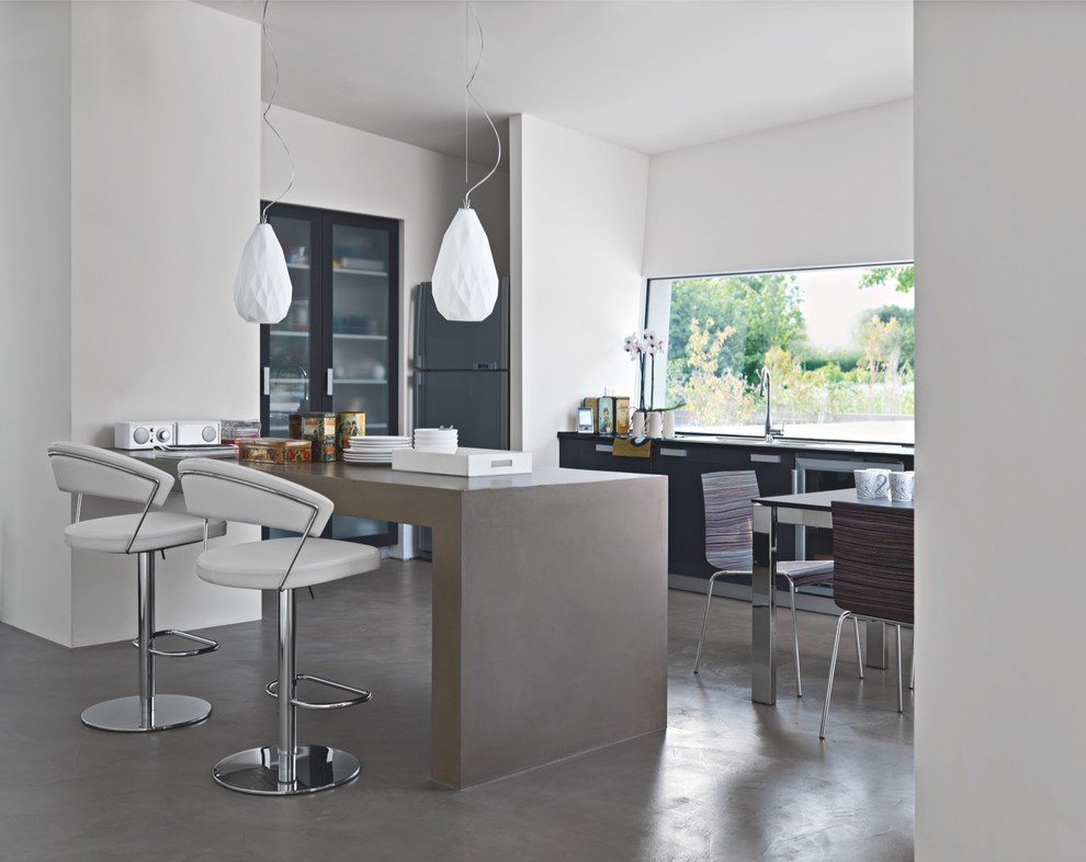 Example of a mid-sized trendy concrete floor open concept kitchen design in San Diego with glass-front cabinets, black cabinets, concrete countertops, stainless steel appliances and an island