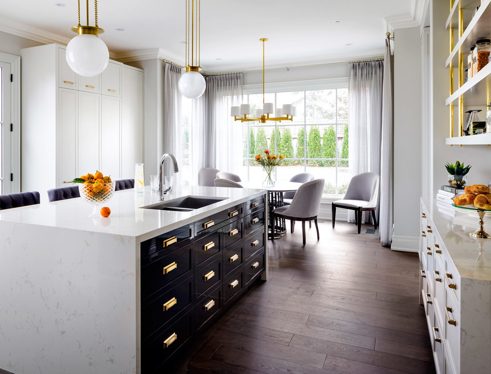 Mid-sized transitional dark wood floor eat-in kitchen photo in Orlando with a double-bowl sink, flat-panel cabinets, black cabinets, an island, marble countertops and stainless steel appliances