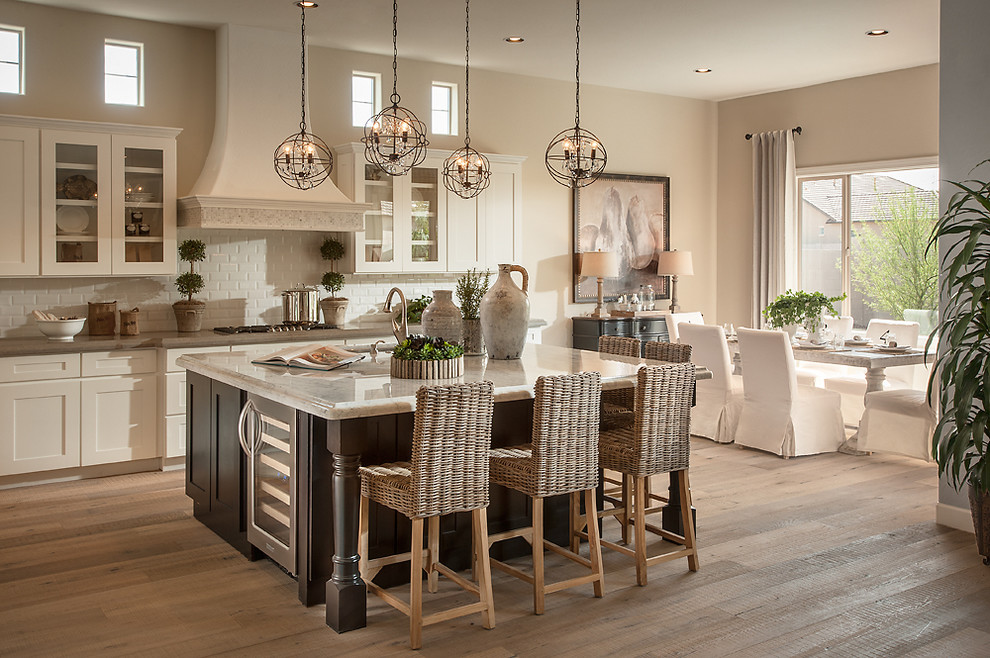 Eat-in kitchen - transitional eat-in kitchen idea in Phoenix with recessed-panel cabinets, white cabinets, soapstone countertops, white backsplash, subway tile backsplash and stainless steel appliances