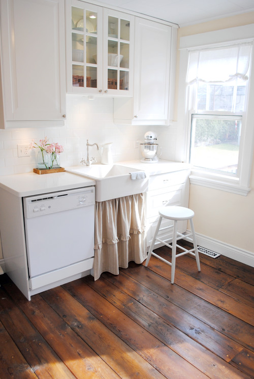 White Farmhouse Cottage Kitchen with Glass Pane Cabinets