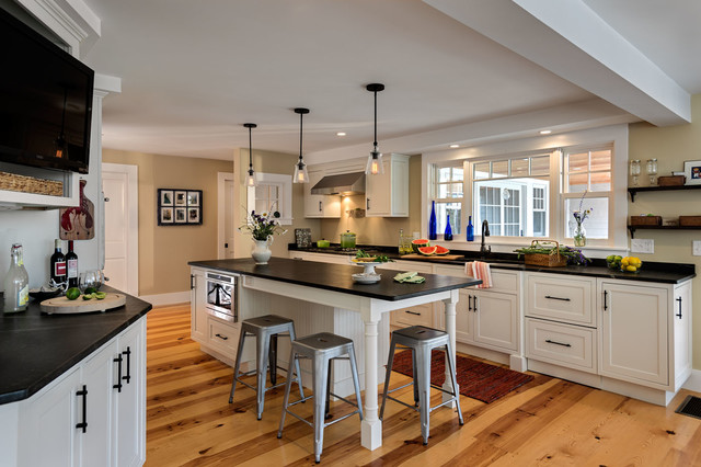 Example Of A Mid Sized Classic Galley Medium Tone Wood Floor Kitchen Design  In Boston