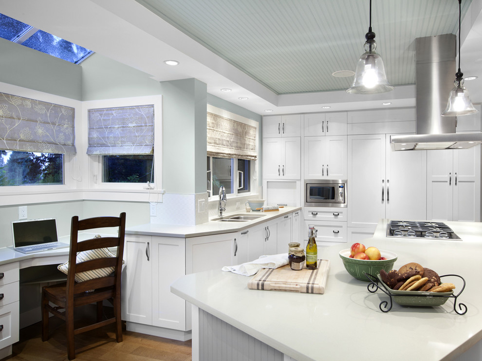 Kitchen - transitional kitchen idea in Vancouver with stainless steel appliances, an undermount sink, shaker cabinets and white cabinets