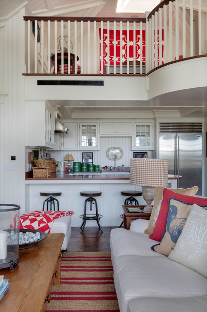 Inspiration for a beach style u-shaped medium tone wood floor open concept kitchen remodel in Boston with glass-front cabinets, white cabinets, stainless steel appliances, a farmhouse sink, wood countertops and no island