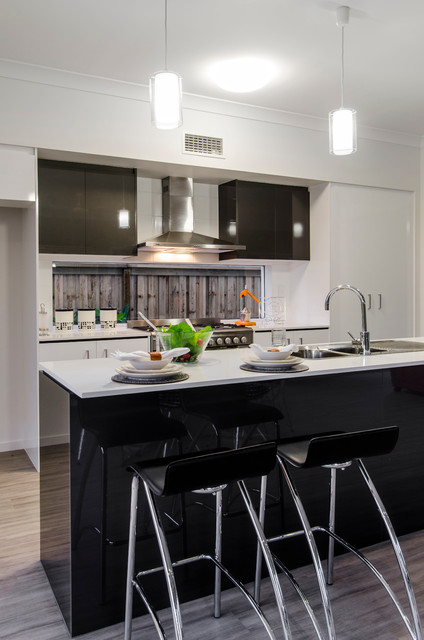 Mid-sized trendy galley vinyl floor eat-in kitchen photo in Brisbane with a double-bowl sink, flat-panel cabinets, black cabinets, quartzite countertops, stainless steel appliances and an island