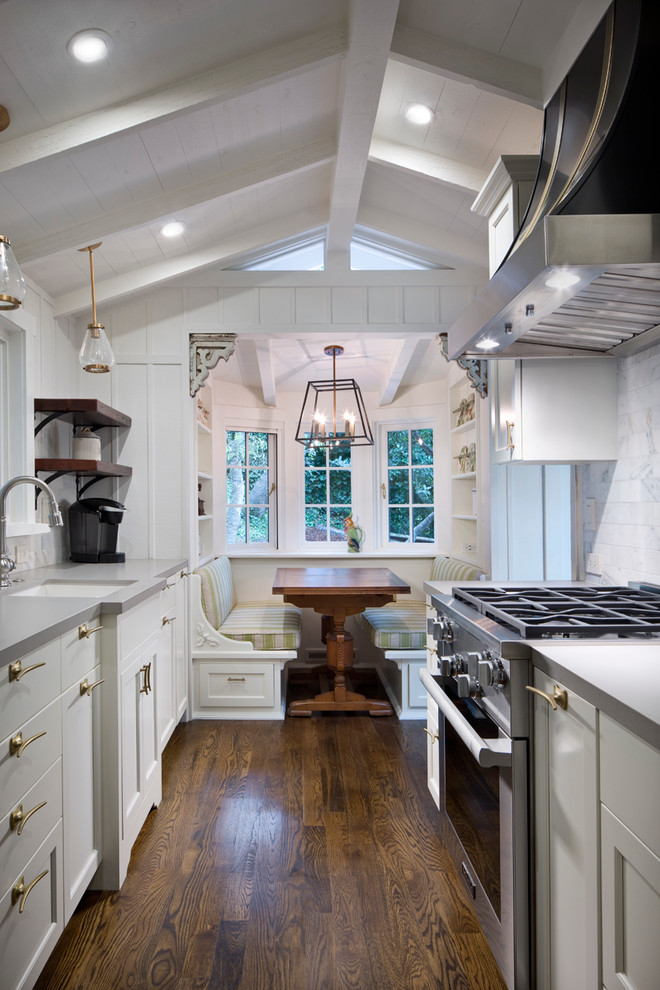 Eat-in kitchen - mid-sized transitional galley dark wood floor and brown floor eat-in kitchen idea in Other with recessed-panel cabinets, white cabinets, stainless steel appliances, no island, an undermount sink, solid surface countertops, white backsplash and marble backsplash