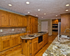 Carnival Granite and Pine Cabinets traditional-kitchen