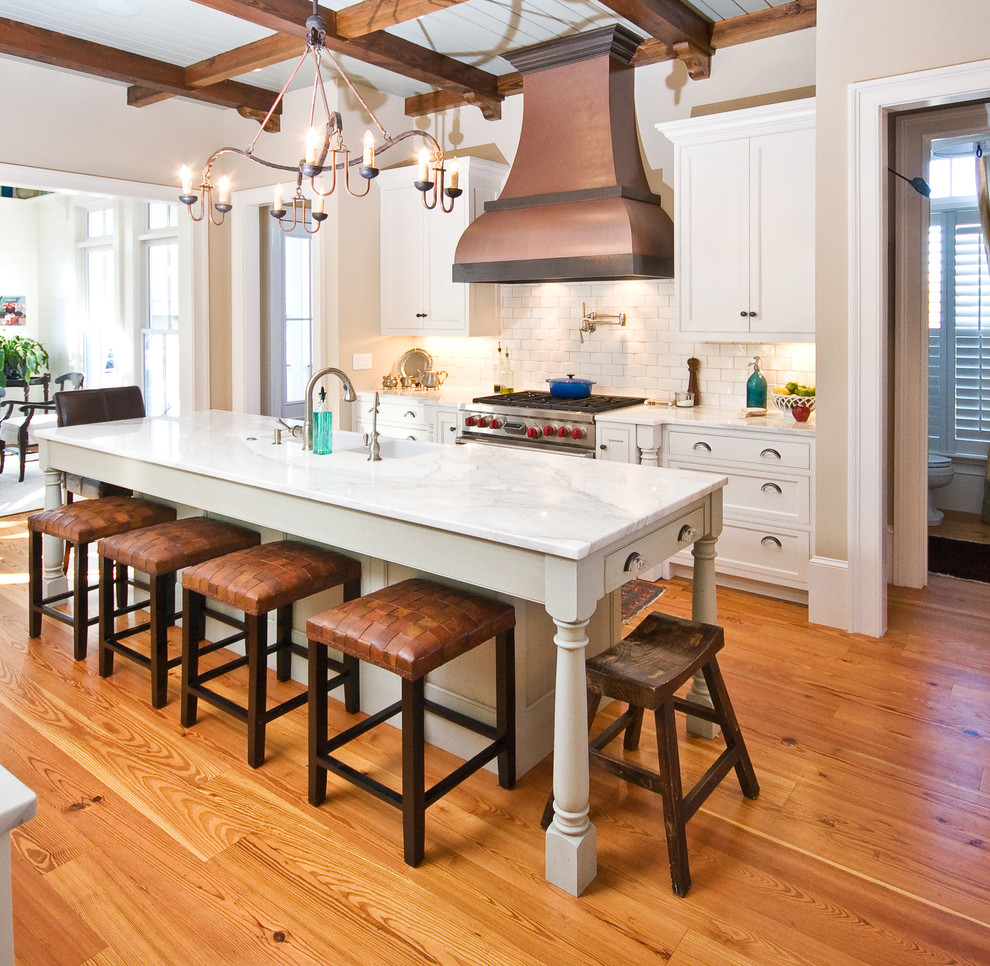Elegant kitchen photo in Charleston with white cabinets, marble countertops, white backsplash, subway tile backsplash and stainless steel appliances