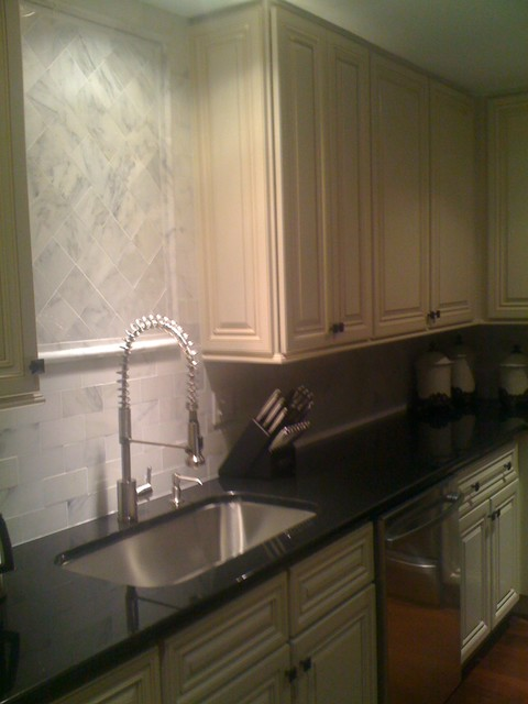 carrera marble backsplash traditional kitchen