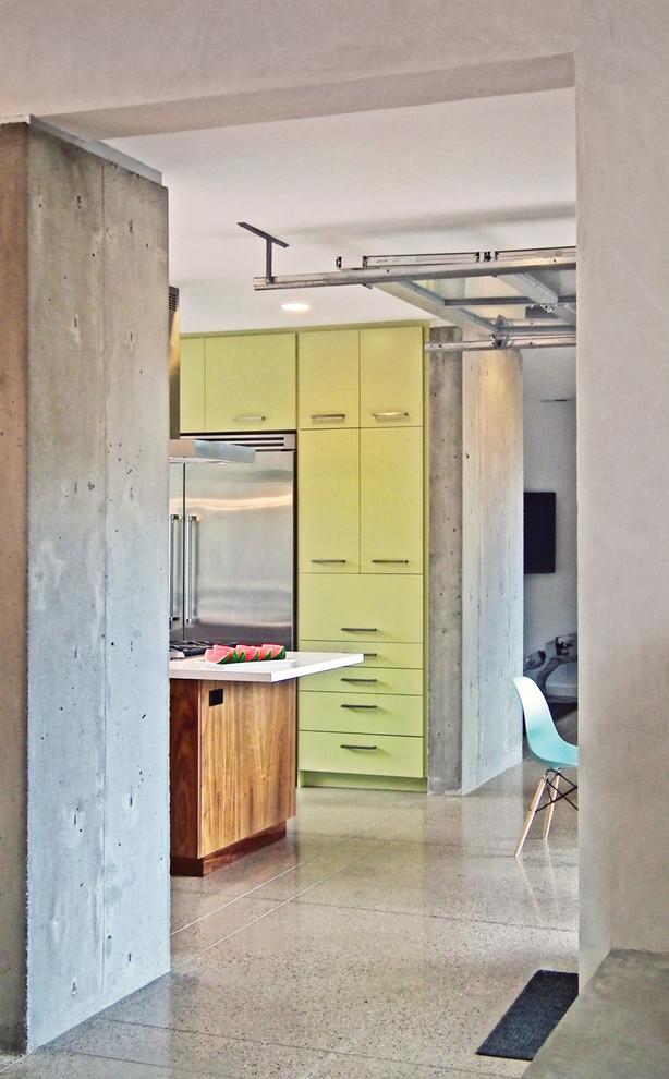 Example of a minimalist kitchen design in Denver with green cabinets