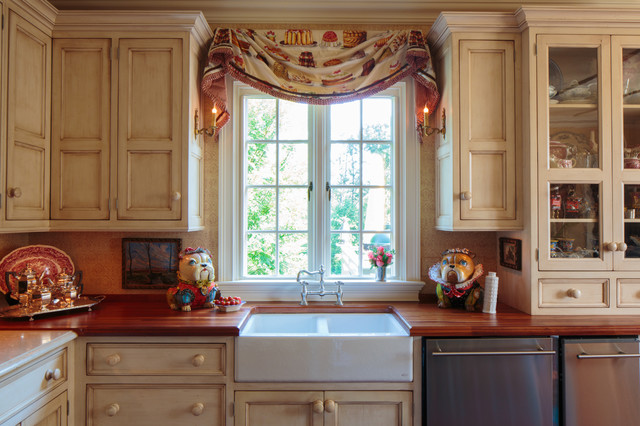 Example Of A Tuscan Kitchen Design In Other With A Farmhouse Sink,  Recessed Panel