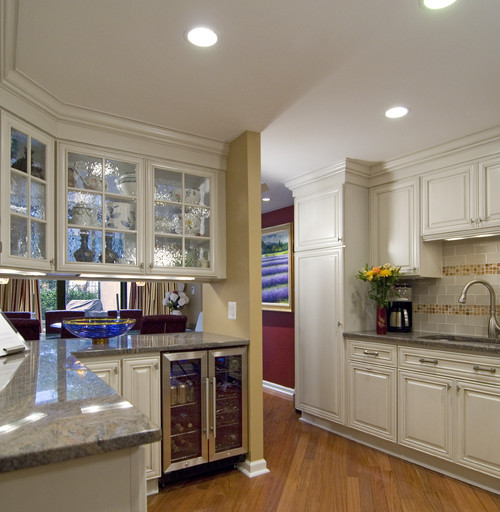 What are the double-sided glass cabinets above the island?