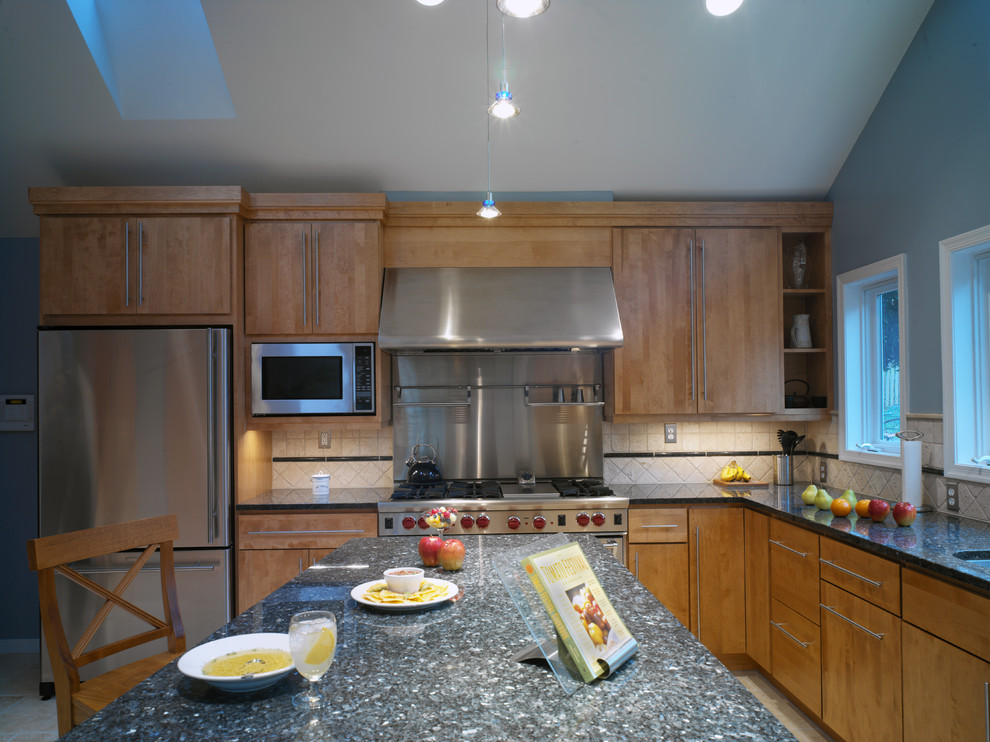 Inspiration for a contemporary l-shaped kitchen remodel in DC Metro with stainless steel appliances, granite countertops, flat-panel cabinets, medium tone wood cabinets and beige backsplash
