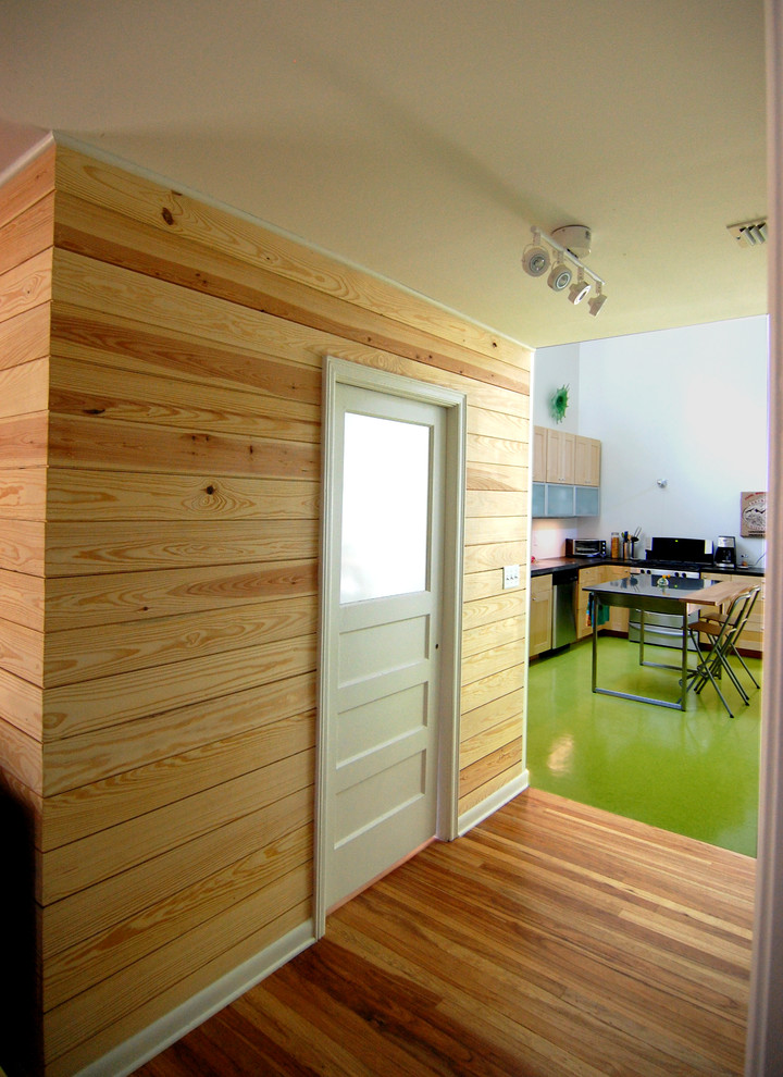 Inspiration for a contemporary green floor eat-in kitchen remodel in Austin with flat-panel cabinets and light wood cabinets
