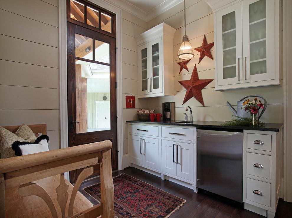 Kitchen - rustic kitchen idea in Atlanta with stainless steel appliances