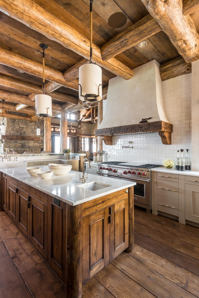 Example of a mountain style l-shaped medium tone wood floor open concept kitchen design in Other with an undermount sink, recessed-panel cabinets, medium tone wood cabinets and white backsplash