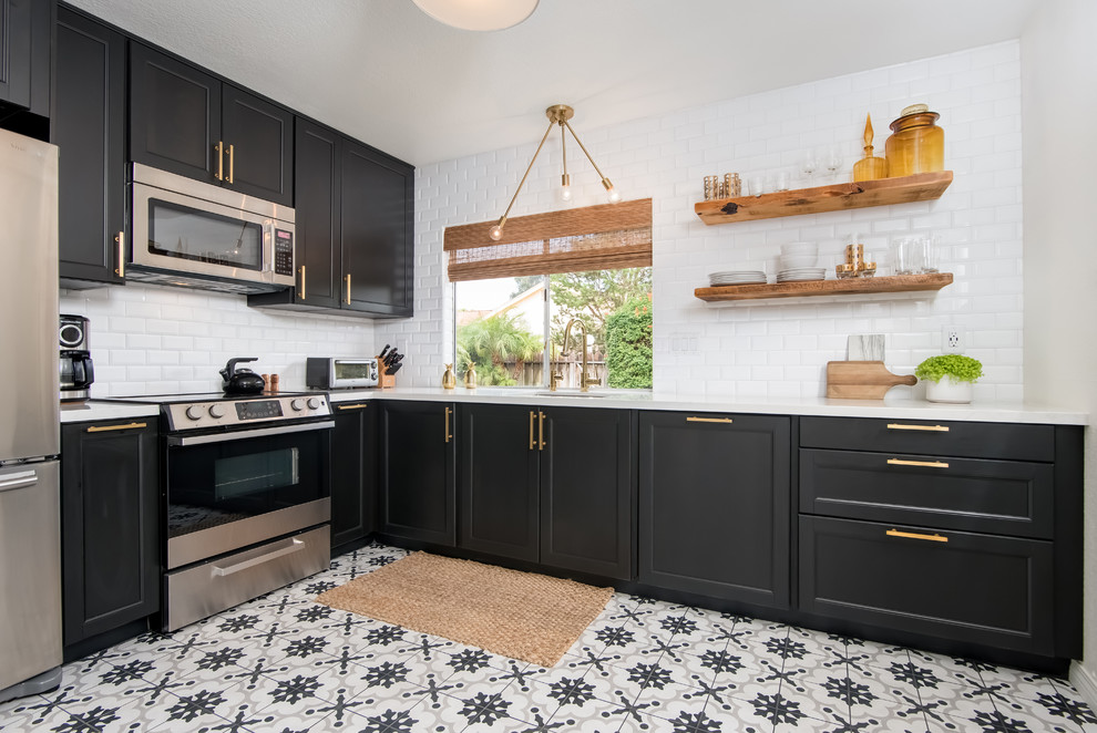 Inspiration for a mid-sized contemporary l-shaped porcelain tile and white floor enclosed kitchen remodel in Los Angeles with an undermount sink, shaker cabinets, black cabinets, quartz countertops, white backsplash, subway tile backsplash, stainless steel appliances and no island